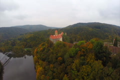 Old Czech castle 11 century Hrad Veveri, river red rooftops, click for HD Stock Footage
