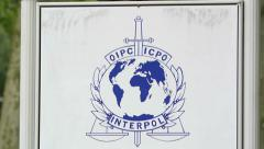INTERPOL logo on parking entrance barrier Stock Footage
