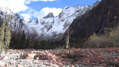 Beautiful snow mountains and red stones in southwest China Stock Footage