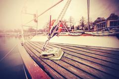 vintage filtered close up picture of yacht rigging. - stock photo