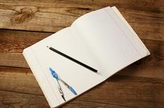 Blank paper, pencil and  compasses, on the wooden table. Stock Photos
