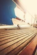 Vintage filtered close up picture of yacht deck and rigging. Stock Photos