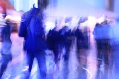 people walking in office, abstract blurred motion - stock photo