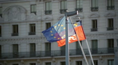European Union Flag and Rhone-Alpes flag on susnset Stock Footage