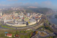 Industrial town aerial shot, trucks railroad, industry buildings, click for HD Stock Footage
