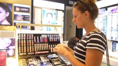 Young Woman Testing Cosmetics in Cosmetics Shop. Stock Footage