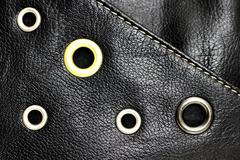 Black leather background with circle studs - stock photo