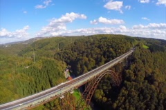 High railroad bridge in Germany Solingen, aerial shot, sunny, click for HD Stock Footage