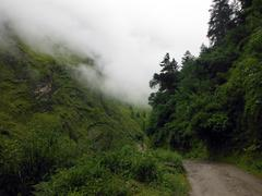 Annapurna Circuit trail in green Himalayas during monsoon Stock Photos