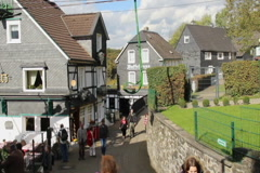 Old German town village, cable way up, houses, tourists walking, click for HD Stock Footage