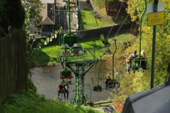 Cable way over river, people tourists ascending descending cabin, click for HD Stock Footage