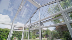 Interior view of glass conservatory in a traditional British home. No people. Stock Footage