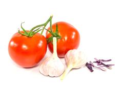fresh red tomato and garlic on white background - stock photo