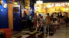 Spectators enter into the auditorium in the children's theater. Stock Footage