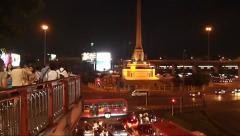 Night Traffic around Victory Monument in Thailand in Lightning Storm, Urban Life Stock Footage
