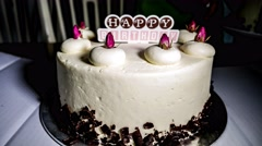 4k Ultra HD time lapse video on cutting a creamy birthday cake Stock Footage