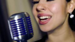 Young singer singing into a microphone. Stock Footage