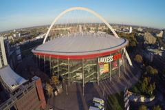 Large concert arena in Cologne, Lanxess, aerial shot, ice hockey, click for HD Stock Footage