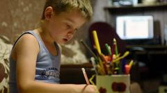 Boy paints Stock Footage