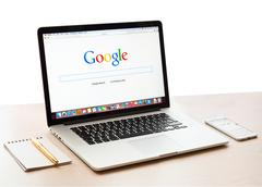 google webpage on macbook pro display - stock photo