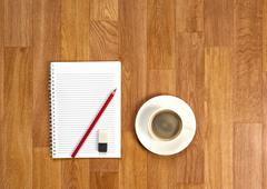 Blank notepad with office supplies and cup of coffee. Stock Photos