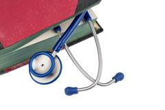 Book and stethoscope Stock Photos
