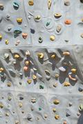 Detail of artificial rock wall for sports climbing Stock Photos