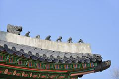 clay dolls on the roof corner of korean traditional architecture - stock photo