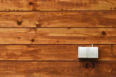 Ac power socket on wooden wall Stock Photos
