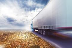 speeding truck on desert road - stock photo