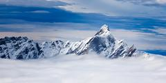 the dent d'hérens is a mountain in the pennine alps, lying on the border bet - stock photo
