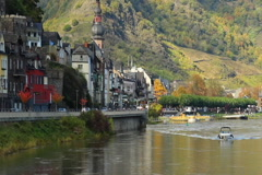 Old European village car traffic quay river boat church building, click for HD - stock footage