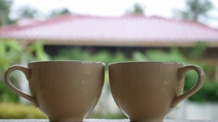 Two Hot Tea Cups with Steam in Garden in Summer Cottage. Stock Footage