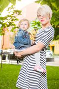 Young mother and her toddler girl - stock photo