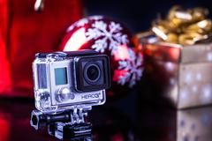 Gopro with christmas background Stock Photos