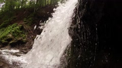 Mountain forest waterfall splashes into the camera Stock Footage