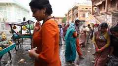 Poor people in the Rain at street market Stock Footage
