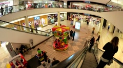 Childs Merry go Round, shopping mall escalator Stock Footage