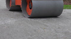Heavy road roller on park pathway Stock Footage