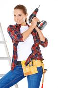 Competent young DIY woman - stock photo