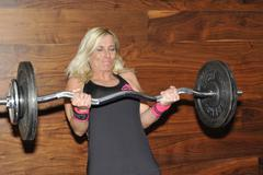 female contestant sandra kievit lifting a national record cheating curl - stock photo