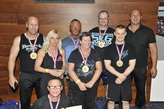 proud male and female contestants showing their medals and trophy's - stock photo