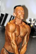 Male bodybuilding contestant showing his triceps Stock Photos