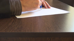 Closeup businessman hand writing on clean sheet, signature required, paperwork Stock Footage