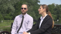 Misunderstanding between businessman and business woman argue discussion outside Stock Footage