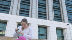 Beautiful successful woman with tablet, corporation view, drinking water thirsty Stock Footage