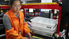 asian woman packaging and  sorting  express delivery package - stock footage
