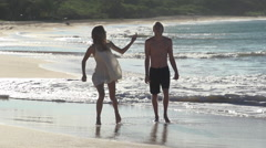 young couple strolling along Big Beach, Maui Stock Footage