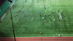 Stock Video Footage of Soccer training at green field, at evening time, top view, timelapse