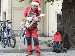 The guitarist in Santa Claus's clothes. Related clips are in my portfolio in HD. Stock Footage